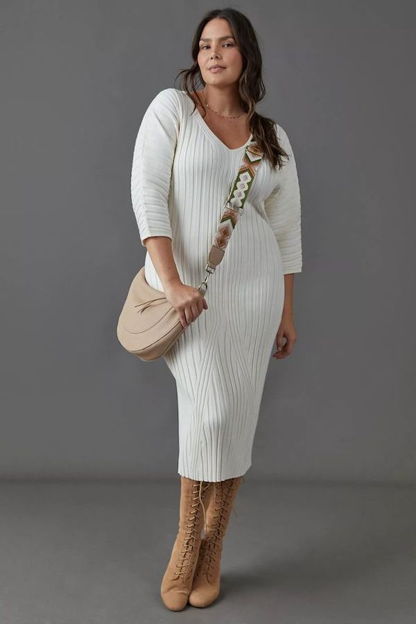 A model wearing a plus-size sexy winter dress in white.