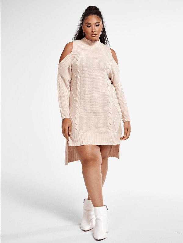 A model wearing a plus-size sexy winter dress in cream.