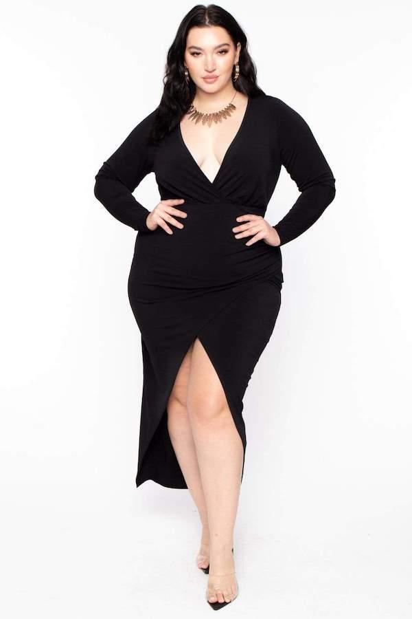 A model wearing a plus-size sexy winter dress in black.