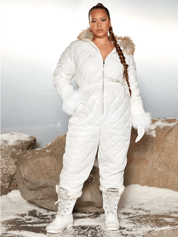 A model wearing a plus-size ski suit in white.