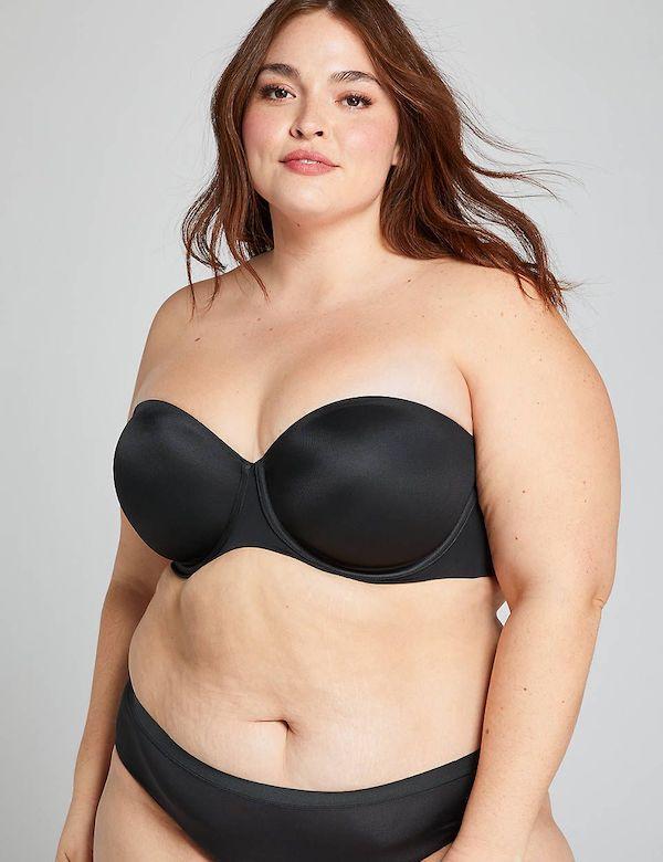 A model wearing a plus-size strapless bra in black.