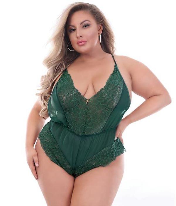 A model wearing a plus-size lingerie teddy in green.