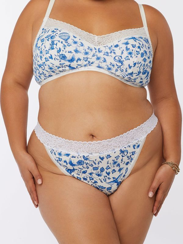 A model wearing a plus-size thong in blue floral print.