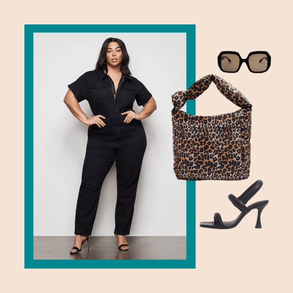 A model wearing a black plus-size utility jumpsuit, a leopard print bag, black heels, and black sunglasses.