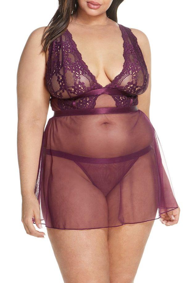 A model wearing a plus-size mesh babydoll.