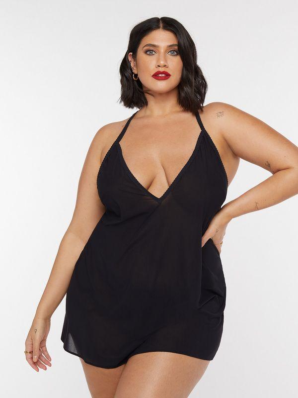 A model wearing a plus-size black slip.