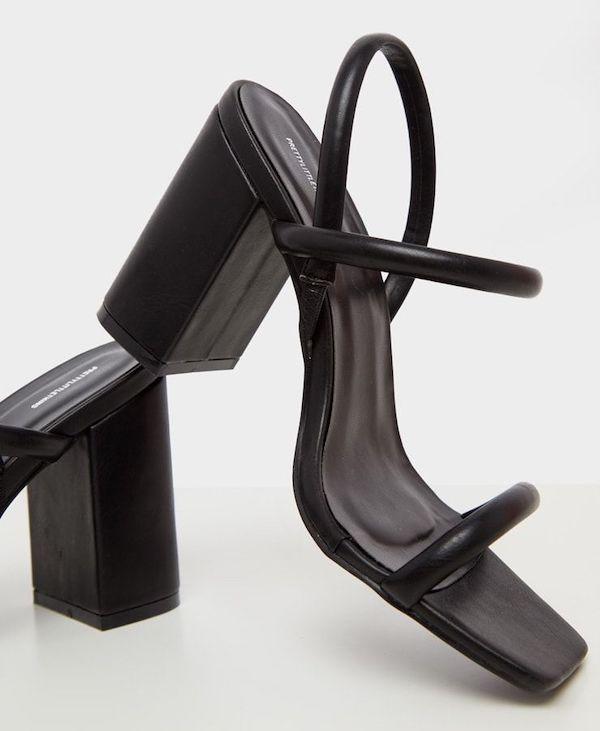 A pair of wide-fit block heels in black.
