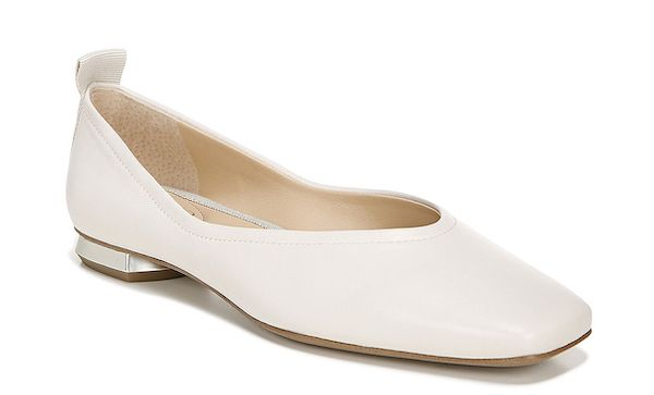Wide-fit flats in white.