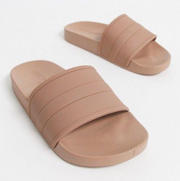 Wide-fit slide sandals in tan.