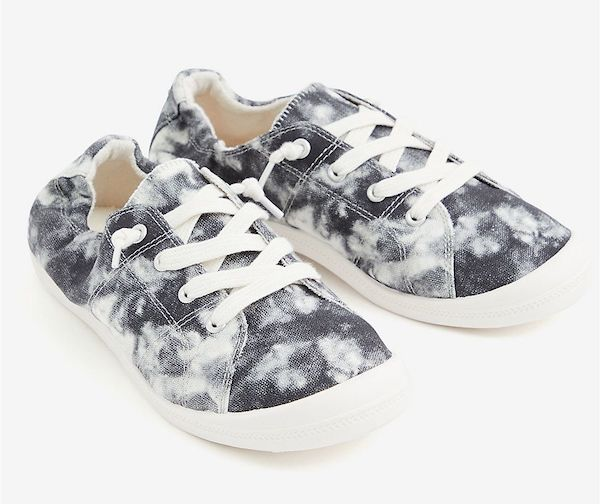 Wide-fit slip-on sneakers in black and white tie-dye.