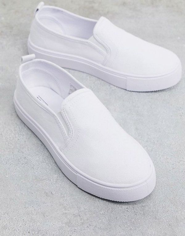 Wide-fit slip-on sneakers in white.