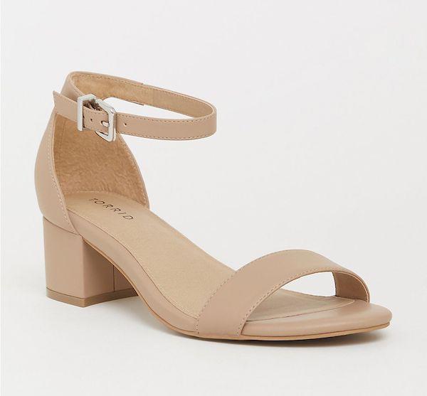 Wide-fit beige low heels.