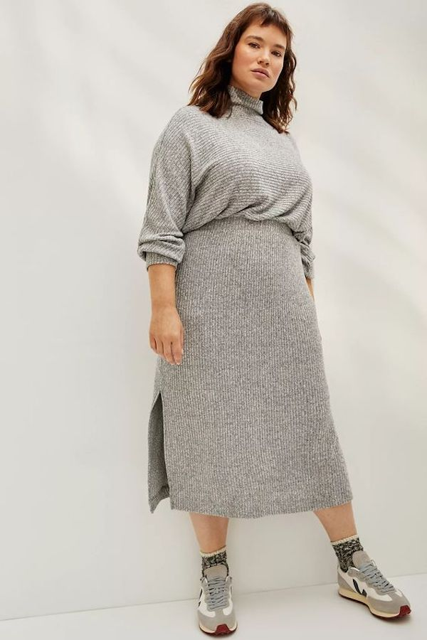 A model wearing a plus-size maxi dress in gray.