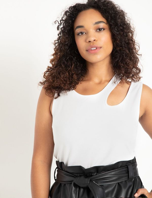 A model wearing a plus-size asymmetric top in white.