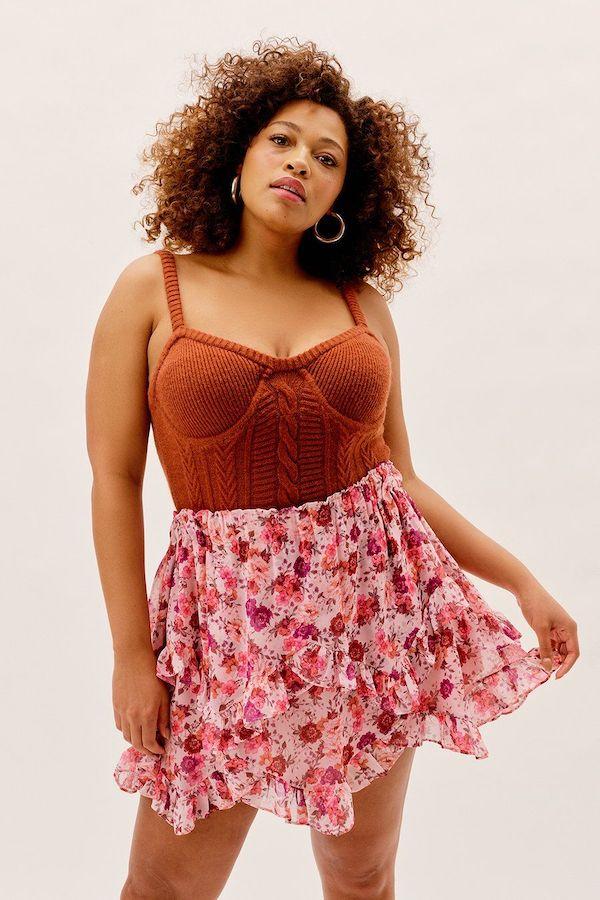 A model wearing a plus-size bustier top in burnt orange.