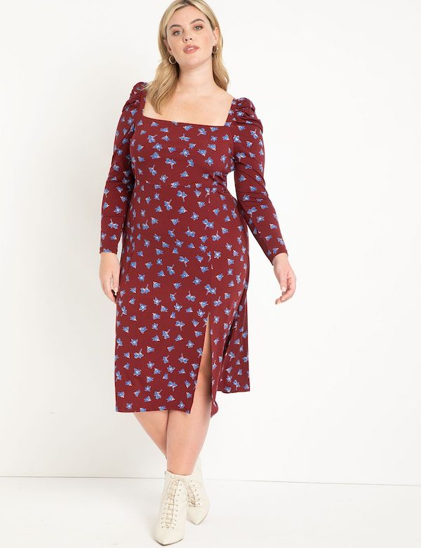 A model wearing a plus-size floral midi dress.