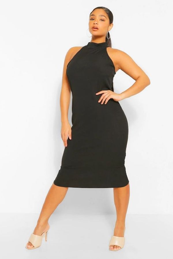 A model wearing a plus-size halter dress in black.
