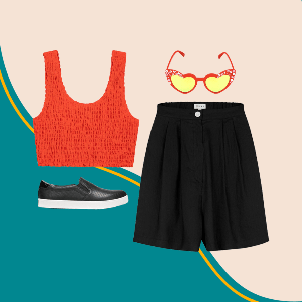 A red crop top, black slip-on sneakers, plus-size black shorts, and red heart-shaped sunglasses.