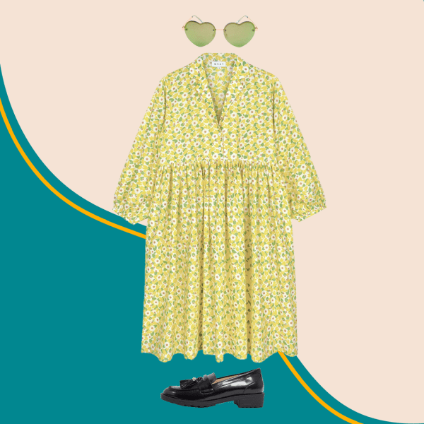 Green heart-shaped sunglasses, green shirtdress, and black loafers.