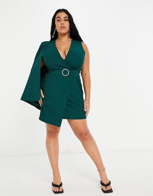 A model wearing a plus-size one-shoulder dress in green.