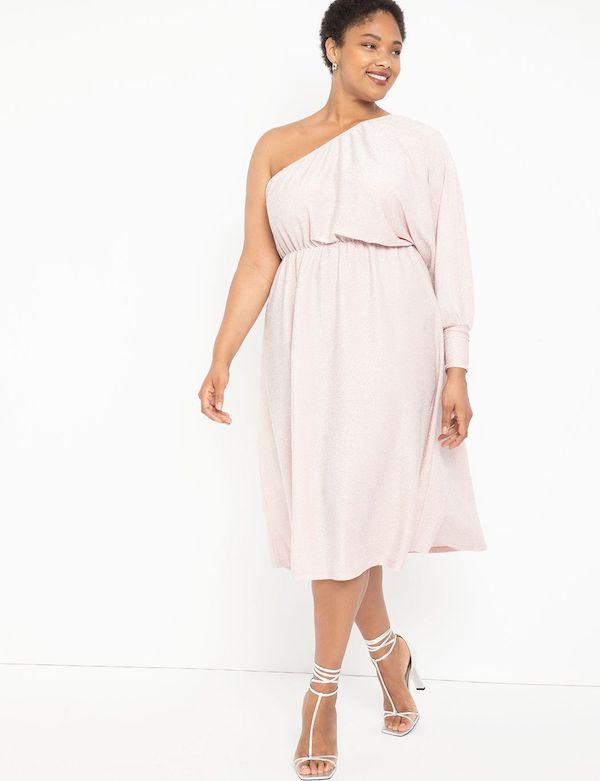 A model wearing a plus-size one-shoulder dress in light pink.