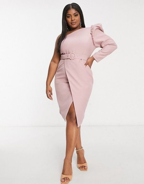 A model wearing a plus-size one-shoulder dress in pink.