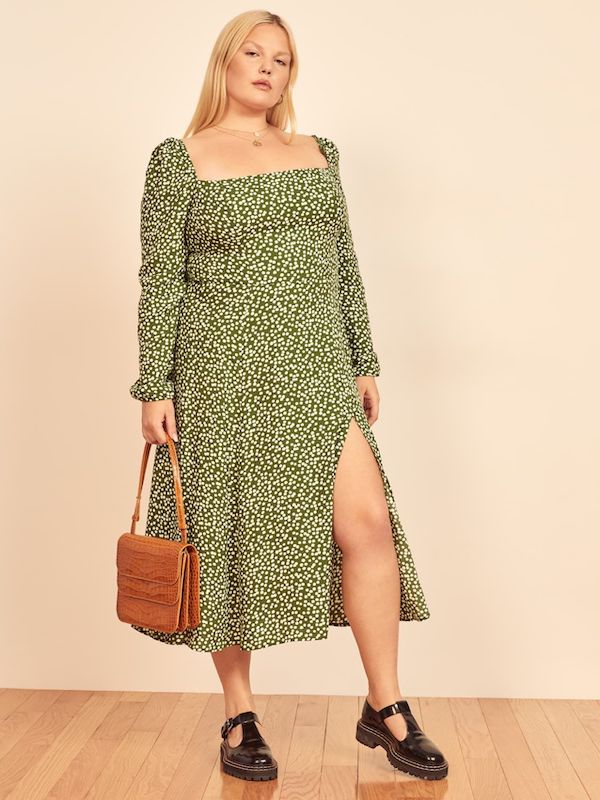 A model wearing a plus-size polka dot dress in green.