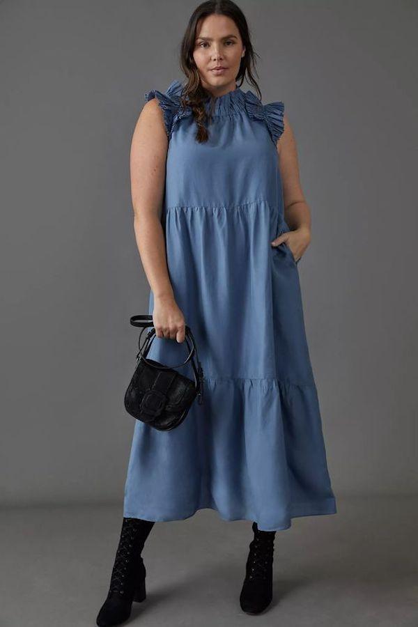 A model wearing a plus-size ruffle dress in blue.