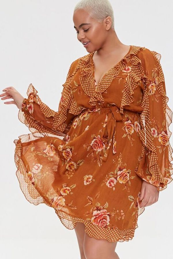 A model wearing a plus-size ruffle dress in brown floral.