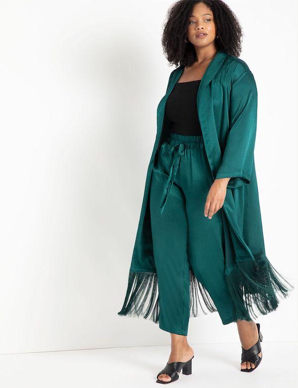 A model wearing plus-size satin pants.