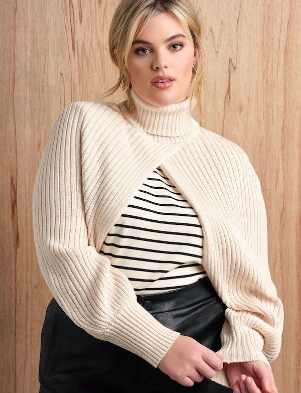 A model wearing a plus-size arm warmer sweater.