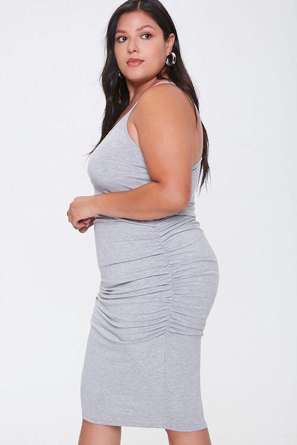 A model wearing a plus-size cami dress.