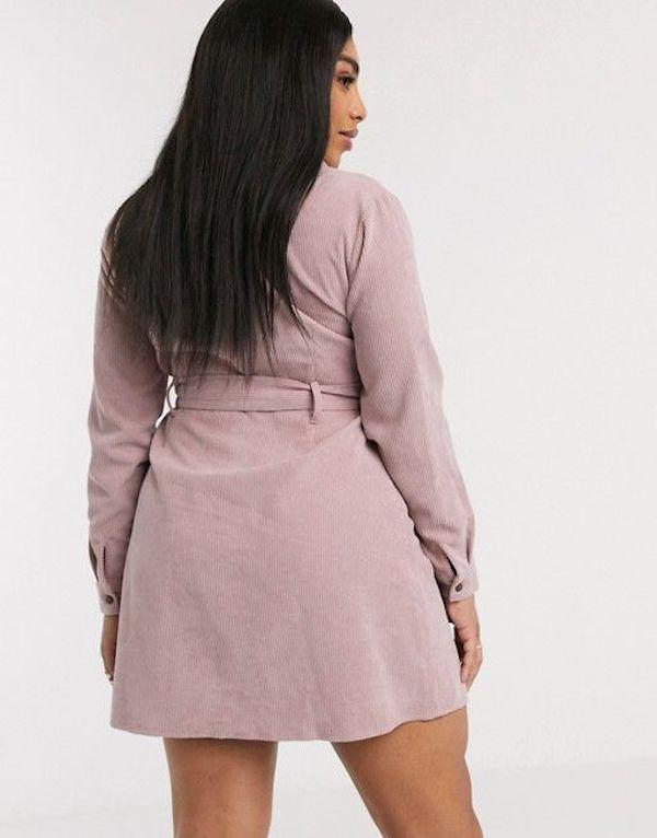 A model wearing a plus-size corduroy dress.