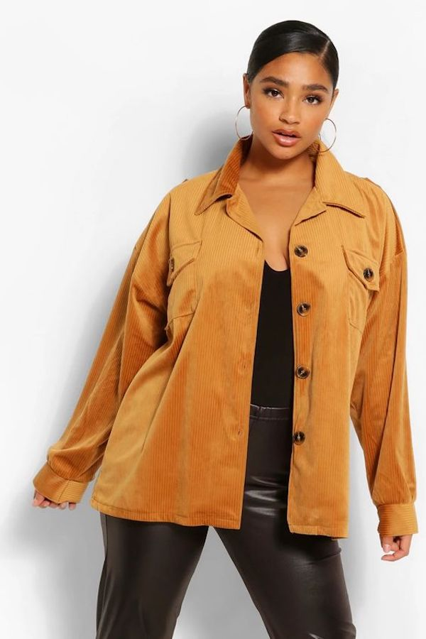 A model wearing a plus-size corduroy jacket.