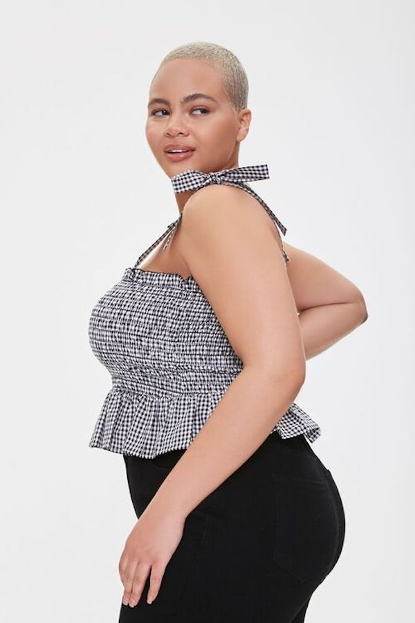 A model wearing a plus-size gingham top.