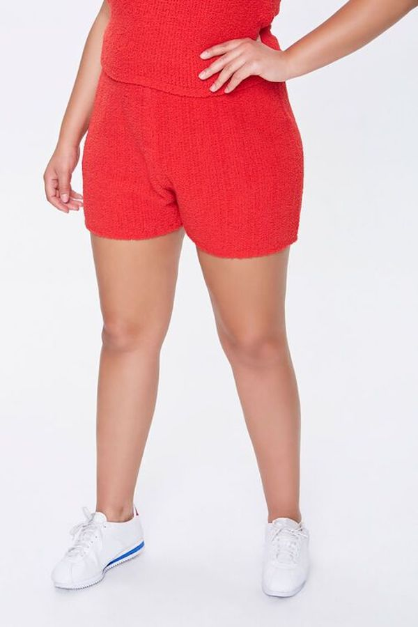 A model wearing a pair of plus-size knit shorts.
