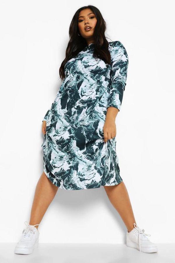 A model wearing a plus-size marble print dress.