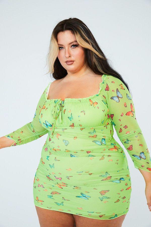 A model wearing a plus-size mesh dress.