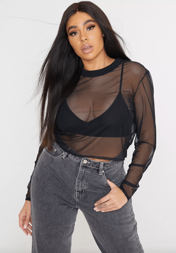 A model wearing a plus-size mesh top.