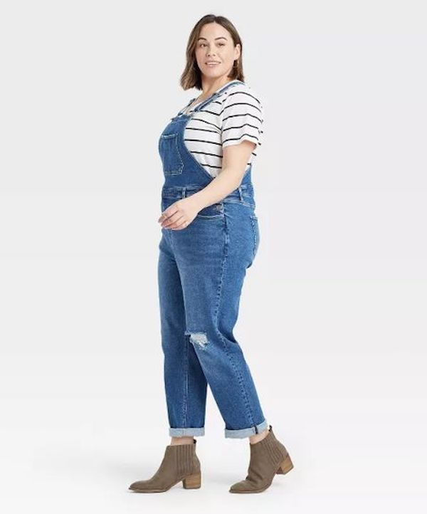 A model wearing a pair of plus-size overalls.