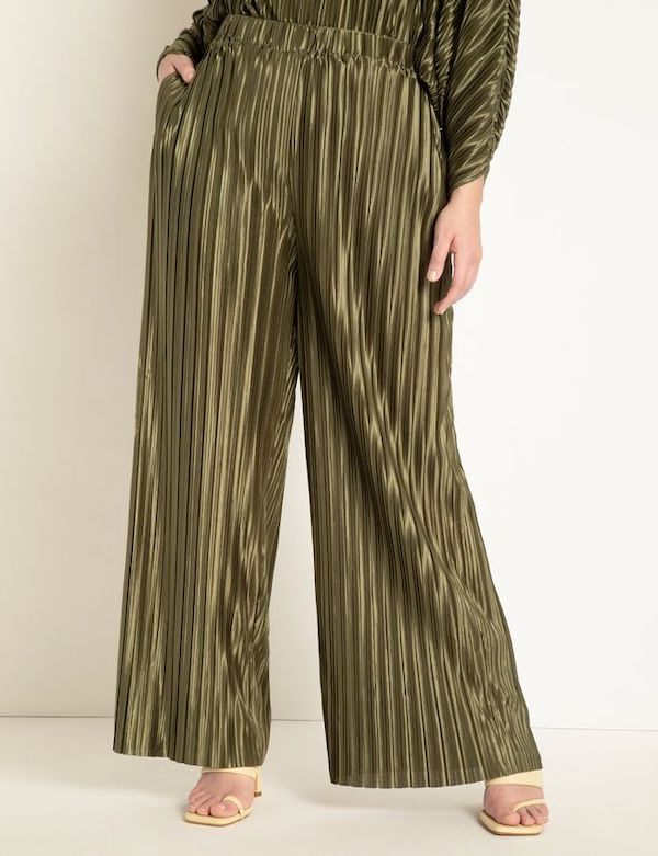 A model wearing green plisse pants from ELOQUII.