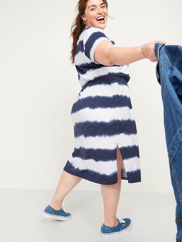 A model wearing a plus-size tie-dye dress.