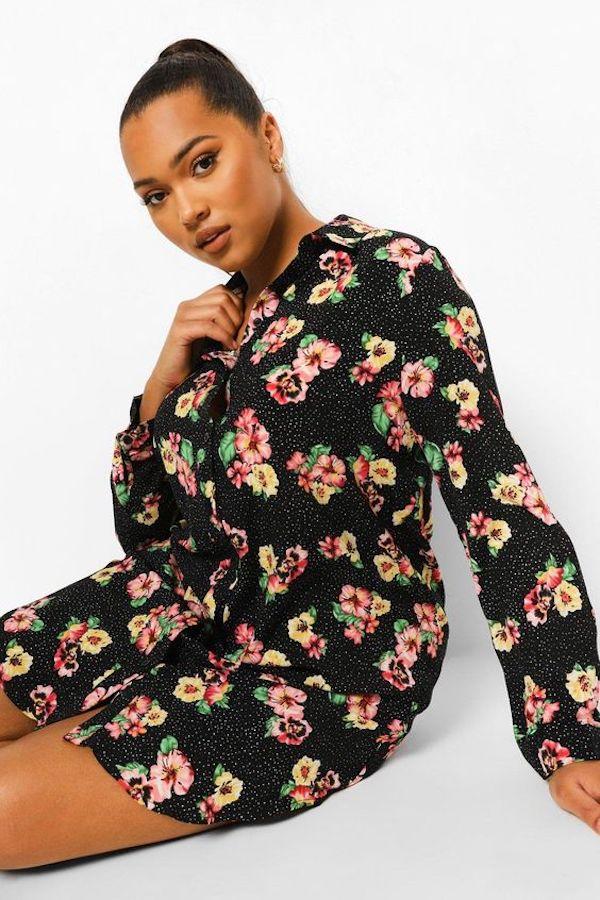 A model wearing a plus-size tropical print dress.
