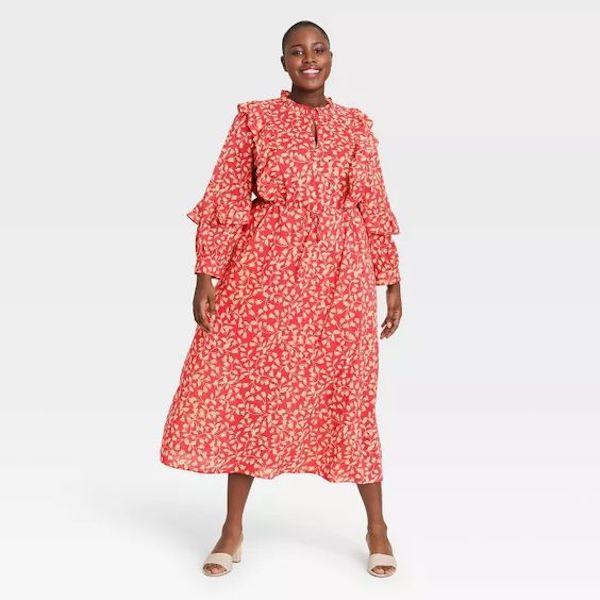 A model wearing a plus-size maxi dress.