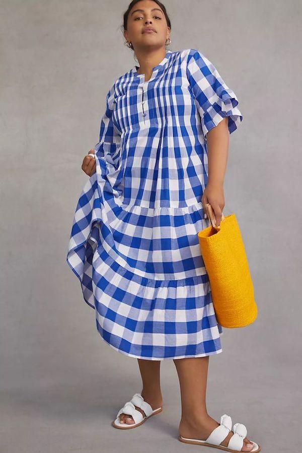 A model wearing a plus-size blue dress.