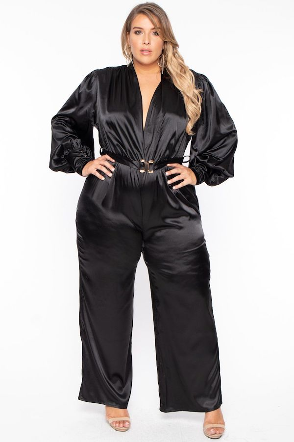 A model wearing a plus-size satin jumpsuit.