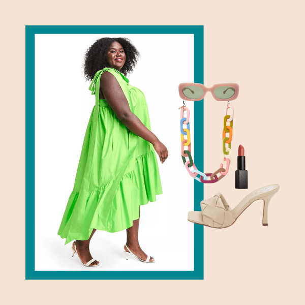 A model wearing a plus-size green dress, sunglasses with a colorful chain, nude heels, and lipstick.
