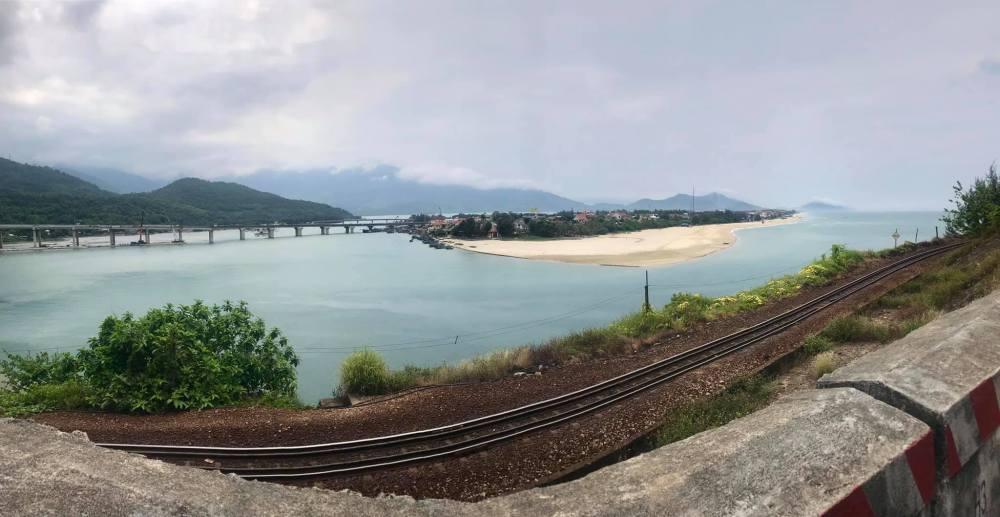 Panorama of the sea, beach ad train tracks at the start of Hai Van Pass