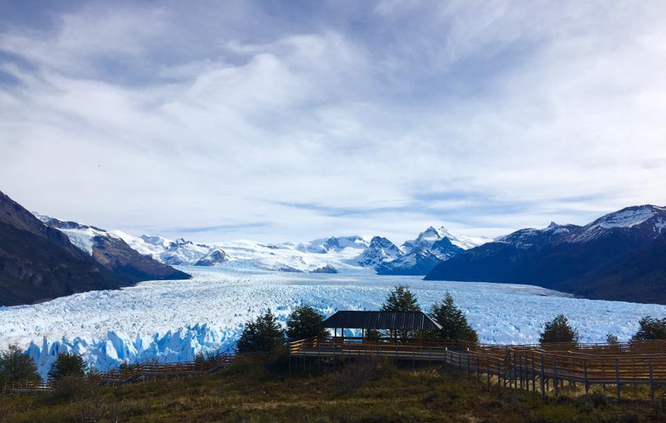 Photo of Perito Moreno Glacier as it spill out from the mountains toards the view point.