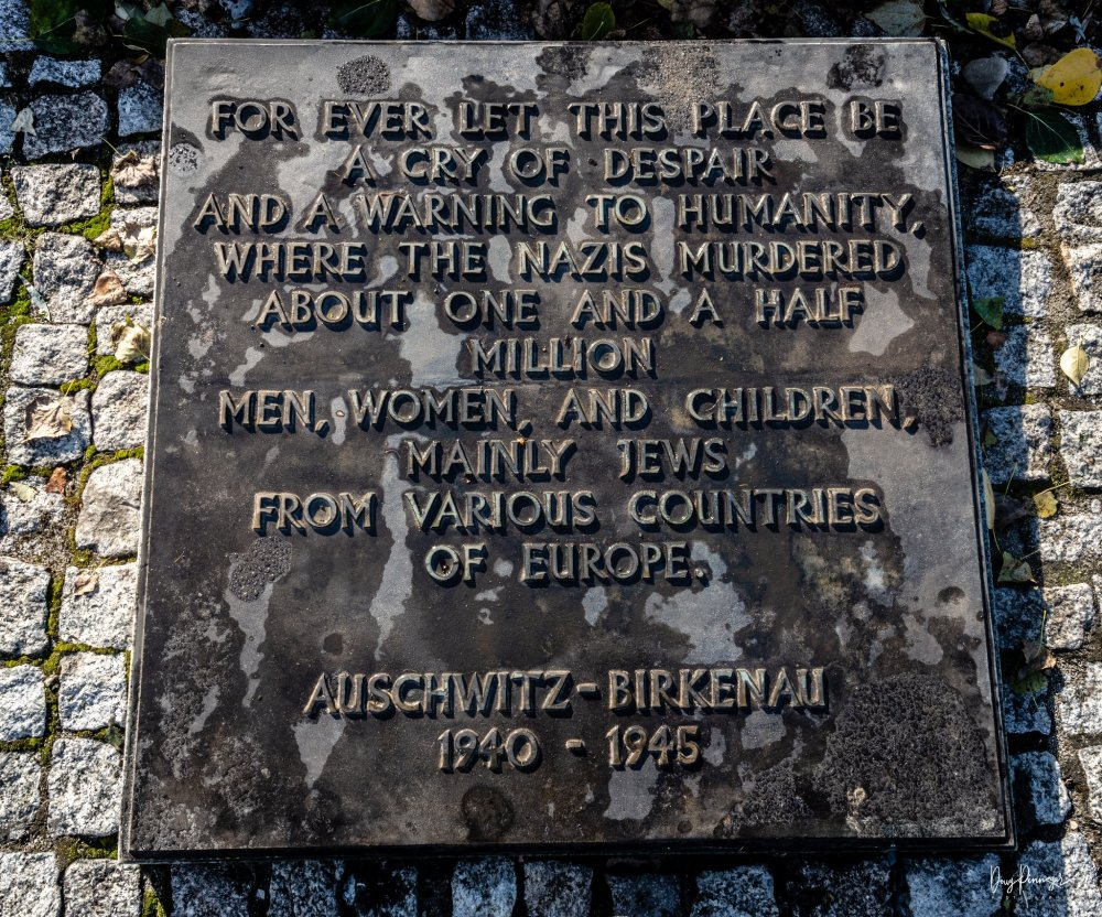 "Plaques lay on the ruins of the gas chambers in Auschwitz Birkenau. It reads ""For ever let this place be a cry of despair and a warning to humanity, where the Nazis  murdered about one and a half million men, women, and children, mainly Jews from various countries in Europe."